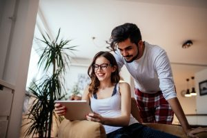 Couple using their digital tablet together