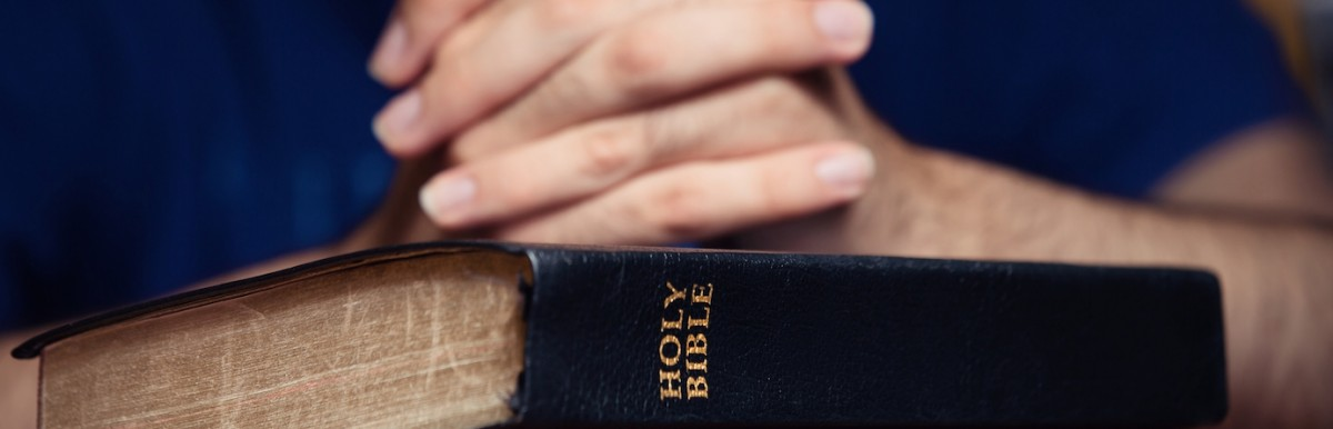 Man-with-Bible-1200x386